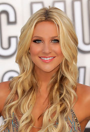 Stephanie Pratt paired her bronzed look with a glossy pink lip.