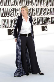 Jane has fun at the MTV Video Music Awards in a floor length track styled trench with a polka dot lining.
