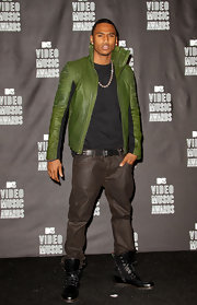 Trey Songz added a splash of color to his look with a green leather jacket, complete with a high collar.