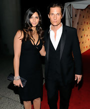 Camila Alves carried an elegant black satin clutch to a Neil Young tribute.