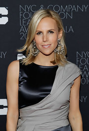Shoe designer Tory Burch added a little sparkle to her look with diamond embellished hoop earrings.