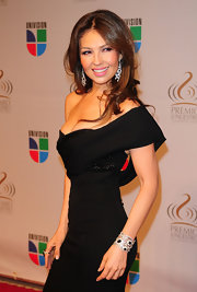 Thalia shows off her tiny figure in this off the shoulder little black dress. Her embellished bodice adds some dazzle.