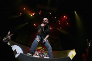 Ripped jeans are par for the course for rockers like Corey Taylor.