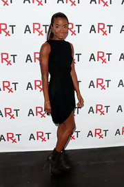 Genevieve Jones looked bold in gray leather high heel ankle-boots at the 2010 RxART party.