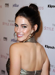 Jessica Lowndes highlighted her natural beauty with a sleek high bun.