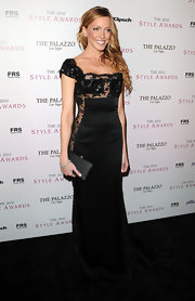 Katie Cassidy opted for an Old Hollywood look with a black satin clutch.