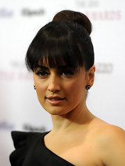 Ana De La Reguera was an elegant beauty in blunt cut bangs and a neat high bun.