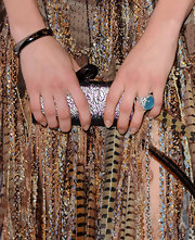 Angela added a nice touch to her embellished dress with a sky blue gemstone ring.