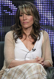Katey Sagal adds contrast to her brown tresses with chunky blond highlights. Here, she wears her medium length hair curled, with slanted bangs.