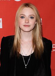 Dakota Fanning accessorized her all-black ensemble with layered silver necklaces.