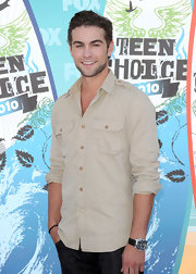 Chace paired his classic button down shirt with a leather band watch complete with a silver face.