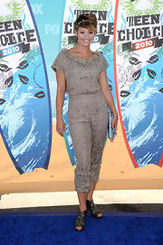 Kimberly walked the blue carpet in an embroidered jumpsuit with a floral-detailed neckline.