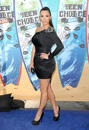 Kim rocked the ever popular sating Triple Platform Pumps with an embellished, asymmetrical mini.