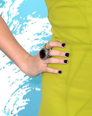 Emma Roberts added some contrast to her look lime green dress with dark nails.