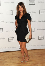 The stunning Miss Christensen looked fabulous in a puffed sleeve, black mini dress with a belted waistline.