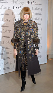 Anna weras a floral embellished evening coat with fur cuffs to the Trophee Des Arts Gala.