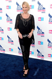 Christina wears a sheer black tunic over leather pants and black Louboutin pumps.
