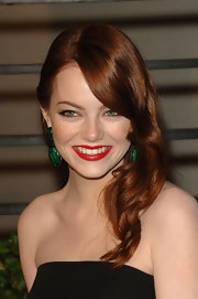 Emma Stone evoked old-Hollywood glamour at the Vanity Fair Oscar party. The actress vamped up her retro waves with a perfect red pout.