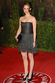 Natalie for a classic black pair of satin peep-tied pumps. Other than her hair, this look was a little dull for us.