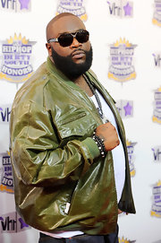 Rick Ross paired his green jacket with designer shields.
