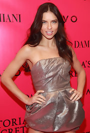 Adriana Lima paired her metallic mini with dark tousled waves.