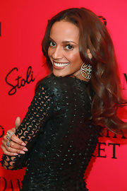 Selita Ebanks showed off her center part long curls while attending the Victoria's Secret Fashion Show. She completed her stunning look with diamond hoop earrings.