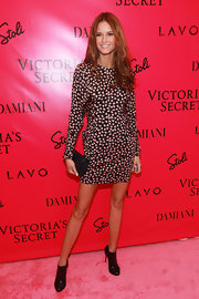 Behati Prinsloo was minimalist chic in a long-sleeve print dress at the Victoria's Secret fashion show after-party.