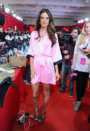 Yet again, Alessandra wore a variation of a pink silk robe backstage for the VS fashion show.