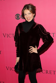 Thalia arrived for the Victoria's Secret Fashion Show wearing a long-sleeved crushed velvet sweater dress.