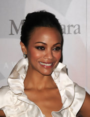 Zoe Saldana showed off her flawless features with a loose bun.