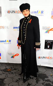 Liza Minnelli attended the 2010 World Aids Day in a military-inspired suit and a floor-length trench.