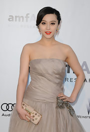 Fan Bingbing accessorized her look with an embellished box clutch.
