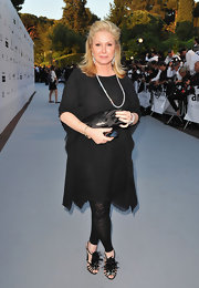 Kathy Hilton was a bit bolder with her footwear, wearing a pair of feather and jewel-embellished evening sandals.