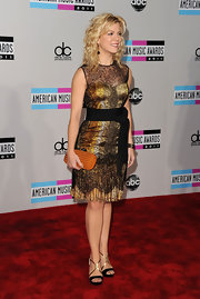 If Kimberly Perry's dress looks familiar it's because we recently saw the spectacular design on Emma Stone. The elegant lacy Bottega Veneta frock looked equally fab on the Band Perry songstress who opted to pair the piece with gold and black evening sandals and the same textured clutch from Emma's look in June. The starlet even opted for the same crimped waves as the redheaded actress!