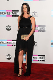 Alanis Morisette's appearance at the AMAs certainly made us nostalgic. The queen of rage went for a darkly romantic look in a black chiffon dress and side fishtail braid. A sparkling clutch and metallic evening sandals added interest to her simple frock.