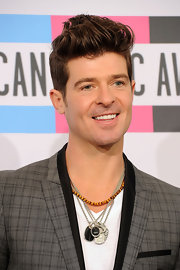 Robin Thicke wore a 6mm tiger's eye spiritual bead necklace, chevron tag necklace and special Pertvs amulet necklace at the 2011 American Music Awards.