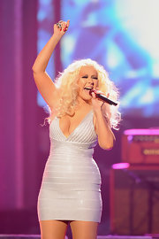 Christina Aguilera hit the stage at the 2011 AMAs in an ultra-tight silver sequined bandage dress.