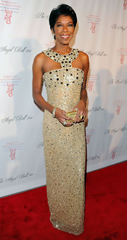 Natalie Cole sparkled in a bead saturated gown with an Egyptian design at the Angel Ball.