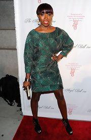 Estelle wore a teal beaded cocktail dress with platform ankle booties for the Angel Foundation benefit.