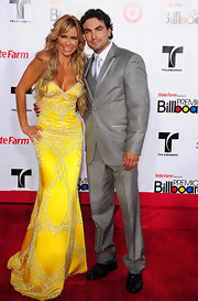 Yellow certainly is Aylin Mujica's color! She glowed in this bright yellow beaded gown.