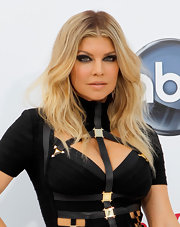 Fergie walked the carpet at the Billboard Music Awards with wavy center part tresses.