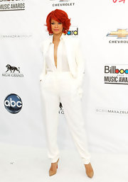 Rihanna maintained the streamlined silhouette of her white suit with pointy tan Christian Louboutin pumps.