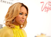 Singer Keri Hilson attended the 2011 Billboard Music Awards wearing Elite earrings in yellow gold.