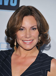 LuAnn wore her chestnut hair in perfectly groomed waves for a night out in NYC.