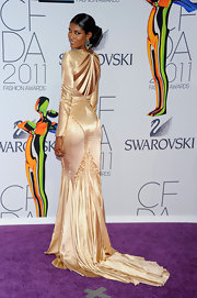 Sessilee looked divine at the CFDA Awards in a satin champagne evening gown with a long train.