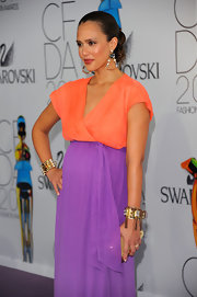 Jessica and a gold bangle bracelet with tassle embellishments to her DVF color-blocked dress.