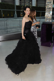Lucy Liu complemented her dramatic feathered gown with a black patent leather Party Time clutch.