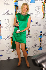 Nadja Swarovski posed backstage at the 2011 CFDA Fashion Awards in an emerald green silk shift featuring a split, dropped hem at the back.