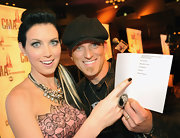 Shawna Thompson's huge statement ring at the 2011 CMA Awards nominations vied for attention with her layered necklaces.