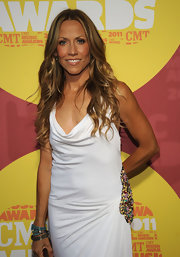 Sheryl Crow added voluminous curls to her shiny locks with long cascading ringlets that fell over her shoulder.